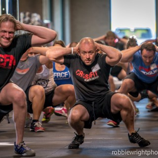 Mike Cole from Trident CrossFit, Alexandria, VA, and Matt Wilcox, CrossFit Devon, England, prepare for an Iron Sharpens Iron training event workout.